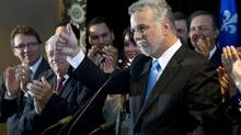 Phillipe Couillard gives a thumbs-up as he announces his candidacy for the leadership of the Quebec Liberals in Montreal on Wednesday. (PAUL CHIASSON/THE CANADIAN PRESS)