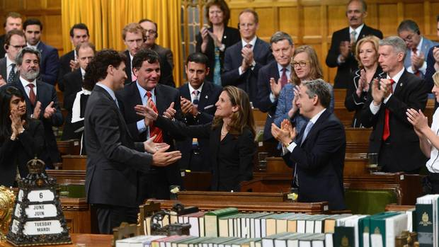 Minister of Foreign Affairs Chrystia Freeland is congratulated by Prime Minister Justin Trudeau and party members after delivering a speech in the House of Commons on Canada's Foreign Policy in Ottawa.