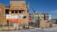 Construction crews build housing and community centres in Saskatoon, Sask., on Feb. 2, 2012. (Liam Richards/THE CANADIAN PRESS)