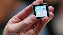 An Apple employee holds a new iPod Nano at an Apple Special Event at the Yerba Buena Center for the Arts in San Francisco, California. A possible future watch-like product could be used to make mobile payments and would operate on Apple's iOS platform, which is the foundation of its iPhone, iPad and iPod Touch consumer devices, the Times said. (Justin Sullivan/Getty Images/Justin Sullivan/Getty Images)