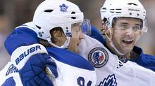 Toronto Maple Leafs Mikhail Grabovski (left) is congratulated by Clarke MacArthur after scoring his team's opening goal against Buffalo Sabres during period NHL hockey action in Toronto on Saturday November 6, 2010.THE CANADIAN PRESS/Chris Young (Chris Young)