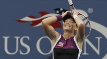 Samantha Stosur of Australia reacts after winning her finals match, defeating Serena Williams of the U.S., at the U.S. Open tennis tournament in New York September 11, 2011. (Reuters)