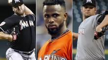 This photo combo made from file photos shows Miami Marlins players, from left, pitcher Mark Buehrle, shortstop Jose Reyes, and pitcher Josh Johnson. Miami traded the three players to the Toronto Blue Jays, a person familiar with the agreement said Tuesday, Nov. 13, 2012. The person confirmed the trade to The Associated Press on condition of anonymity because the teams weren't officially commenting. The person said the trade sent several of the Blue Jays' best young players to Miami. (The Associated Press)