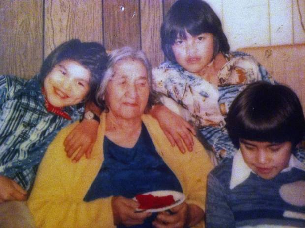 Phillip Tallio, shown at left in the red bandanna, with his grandmother and brothers.