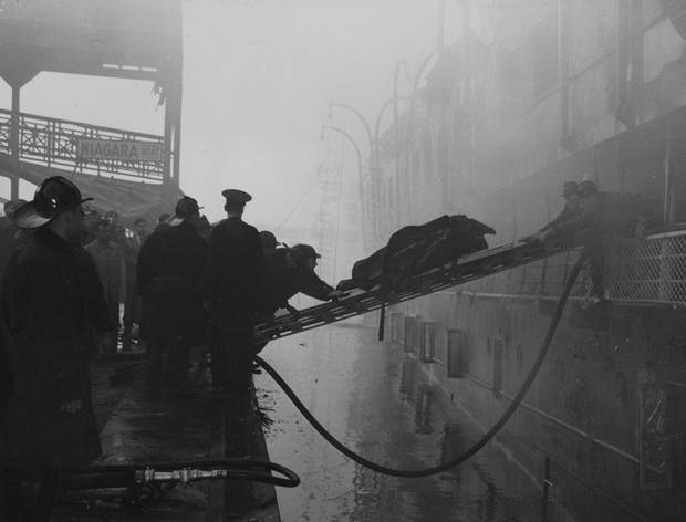 Emergency personnel in Toronto remove victims of the SS Noronic fire on Sept. 17, 1949.