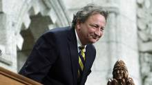Eugene Melnyk, owner of the Ottawa Senators, stands in the visitors gallery as he is recognized in the House of Commons on Parliament Hill (FRED CHARTRAND/The Canadian Press)