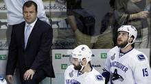Vancouver Canucks' coach Alain Vigneault, left. (Charles Krupa/Charles Krupa/Associated Press)