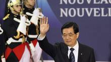 Chinese Presidnt Hu Jintao leaves the conference centre at the G20 summit in Cannes on Thursday. (Dan Kitwood/Dan Kitwood/2011 Getty Images)
