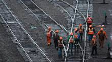 Canadian Pacific railway employees inspect tracks at the company's Port Coquitlam yard east of Vancouver Dec. 4, 2012. (Darryl Dyck for The Globe and Mail)
