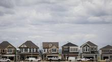 New housing construction in Calgary, Alta. on Thursday, June 26, 2014. (JEFF McINTOSH FOR THE GLOBE AND MAIL)