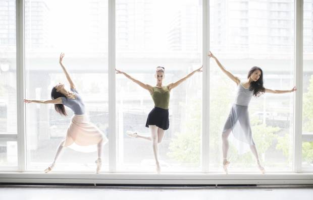 Greta Hodgkinson (L), Sonia Rodriguez (C) and Xiao Nan Yu (R), and pose for a picture at a studio inside the Walter Carsen Centre at the National Ballet of Canada, in Toronto, Friday May 26, 2017.