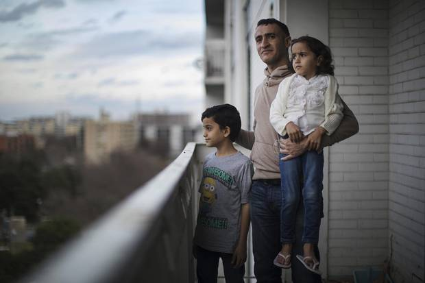 Ali Al-Dhamadi with his daughter Alya 5, and son Taha, 10, at their home in Toronto on Nov. 21, 2017.
