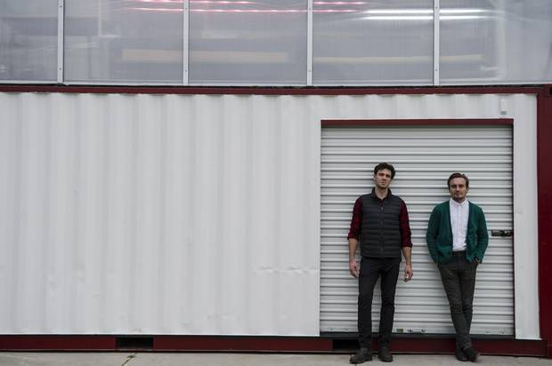 Brandon Hebor, left, and Steven Bourne. This modified shipping container is Ripple's second pilot project in the city, following its inaugural farm at Evergreen Brickworks.