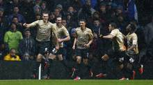 Bradford City's James Hanson (L) celebrates with teammates after scoring during their English League Cup semi-final second leg soccer match against Aston Villa at Villa Park in Birmingham, central England, January 22, 2013. (DARREN STAPLES/REUTERS)