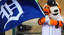 Detroit Tigers mascot Paws waves flag in the seventh inning in game three of the 2011 ALDS against the New York Yankees at Comerica Park. Andrew Weber-US PRESSWIRE (Andrew Weber/US PRESSWIRE)