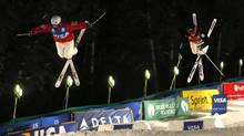 Third place finisher Bradley Wilson of the U.S. (L) and first place finisher Alex Bilodeau of Canada, compete during the men's dual mogul final at the FIS World Cup Freestyle skiing competition in Park City, Utah, February 2, 2013. (JIM URQUHART/REUTERS)