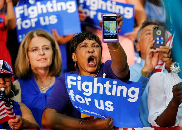 A Hillary supporter yells out with a picture of Donald Trump on her phone as U.S. Democratic presidential candidate Hillary Clinton speaks during a campaign stop in Fresno, California, on June 4.