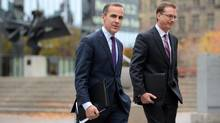 File photo of Mark Carney, governor of the Bank of Canada, and Senior Deputy Governor Tiff Macklem making their way to a press conference at the National Press Theatre in Ottawa, Ont., Wednesday, Oct. 24, 2012. (Sean Kilpatrick/THE CANADIAN PRESS)