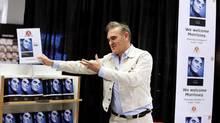 British music star and songwriter Morrissey displays his autobiography, called Autobiography during a signing event. (TT NEWS AGENCY/REUTERS)