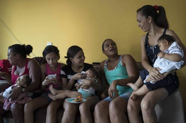 Mothers and friends hold their babies, born with microcephaly, one of many serious medical problems that be caused by congenital Zika syndrome, on Oct. 1, 2016 in Recife, Pernambuco state, Brazil.