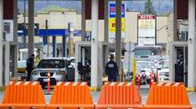 CBSA border guards inspect vehicles at the Sumas border crossing in Abbotsford, B.C. on April 2, 2013. (Ben Nelms for The Globe and Mail)