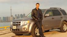 David Sutcliffe and his 2008 Ford Escape hybrid.