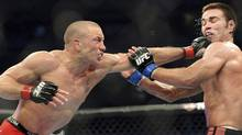 Georges St-Pierre, left, battles against Jake Shields during the welter weight championship match at UFC 129 in Toronto on Saturday, April 30, 2011. (The Canadian Press)
