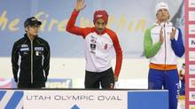 First Place finisher Gilmore Junio of Canada, right, second place Joji Kato of Japan, left, after the men's 500 meter during the Essent ISU speedskating World Cup at Utah Olympic (JIM URQUHART/USA TODAY SPORTS)