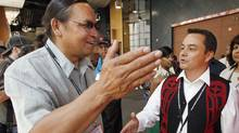 Chief Shawn Atleo (R) from British Columbia talks to candidate chief Terrance Nelson after the first ballot at the Canadian Assembly of First Nations annual meeting in Calgary, July 22, 2009. (Todd Korol/Reuters/Todd Korol/Reuters)
