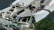 Concrete, iron work, and vehicles lie on the collapsed surface of the I-35W bridge that spans the Mississippi River in Minneapolis, Minnesota, August 2, 2007. The bridge collapsed during rush hour on August 1. (stringer/usa/stringer/usa/REUTERS)