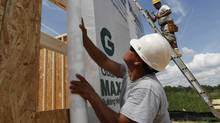 Construction workers frame a new house in Chester, Va. (Steve Helber/AP)