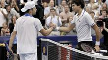 Andy Roddick, left, of the United States, and Milos Raonic, of Canada, shake hands after Roddick won the Regions Morgan Keegan Championships tennis tournament Sunday, Feb. 20, 2011, in Memphis, Tenn. (Mark Humphrey/AP)