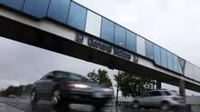 Cars pass under an overpass at the General Motors Car assembly plant in Oshawa, June 1, 2012. General Motors Co said on Friday it expects to close one of the two lines at its Oshawa, Ontario, assembly plant by June 1, 2013. The consolidated assembly line, which employs about 2,000 workers, was originally expected to cease production in 2008, GM said in November 2005. But production was extended due to market demand for the Chevrolet Impala and Chevrolet Equinox crossover, GM said. (Mark Blinch/Reuters)