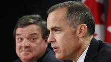 Bank of Canada Governor speaks during a news conference with Canada's Finance Minister Flaherty in Ottawa (Chris Wattie/Reuters)