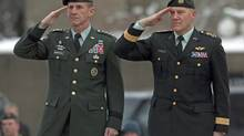 Chief of Defence Staff General Walt Natynczyk, right, and General Stanley McChrystal, the commander of U.S. forces in Afghanistan, take part in a wreath-laying ceremony at the National War Memorial in Ottawa on Tuesday December 15, 2009. (Adrian Wyld)
