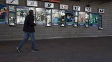 A man walks past the box office outside Rogers Arena in Vancouver, B.C., on Monday, September 17, 2012. (JONATHAN HAYWARD/THE CANADIAN PRESS)