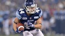 Toronto Argonauts running back Chad Kackert runs the ball up field during third quarter of the Grey Cup against the Calgary Stampeders in Toronto on Sunday, November 25, 2012. (Nathan Denette/THE CANADIAN PRESS)