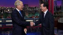 "This May 4, 2011 image from video released by CBS shows host David Letterman, left, shaking hands with fellow talk show host Stephen Colbert of ""The Colbert Report,"" during a surprise visit on the ""Late Show with David Letterman,"" in New York. CBS on Thursday, April 10, 2014, announced that Colbert, the host of ""The Colbert Report,"" will succeed David Letterman as the host of ""The Late Show."" ( (CBS, Worldwide Pants Inc./AP)"