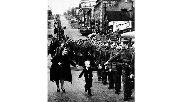 "The photo ""Wait for me, Daddy"" shows Private Jack Bernard saying goodbye to his five-year-old son Warren as he leaves for the Second World War in New Westminster, B.C., on Oct. 1, 1940. (Claude P. Dettloff/The Canadian Press/The National Archives of Canada)"