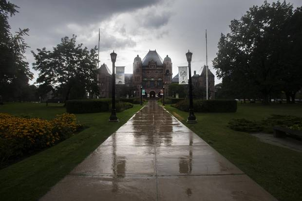 The Ontario Legislature at Queens Park gets doused with rain on Tuesday. The dark cloud hanging above the province's governing Liberals looks set to burst as well.