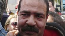 Chokri Belaid, a prominent Tunisian opposition politician, in Tunis on Jan. 28: He was shot and killed on Wednesday. (REUTERS)
