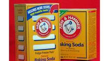 NYR115 Church & Dwight Co., which owns the Arm & Hammer Baking Soda brand, said Tuesday, March 8, 1994, that it has developed a new, slightly larger box with vents, left, that will soon show up on grocery shelves next to the traditional boxes, right, of the versatile concoction. The distinctive yellow boxes already have a purpose deodorizing most American refrigerators, its marketers say. Now they want a spot in the freezer and, while you're at it, maybe the closet and the clothes hamper. (AP Photo/Richard Drew) (Richard Drew/AP)