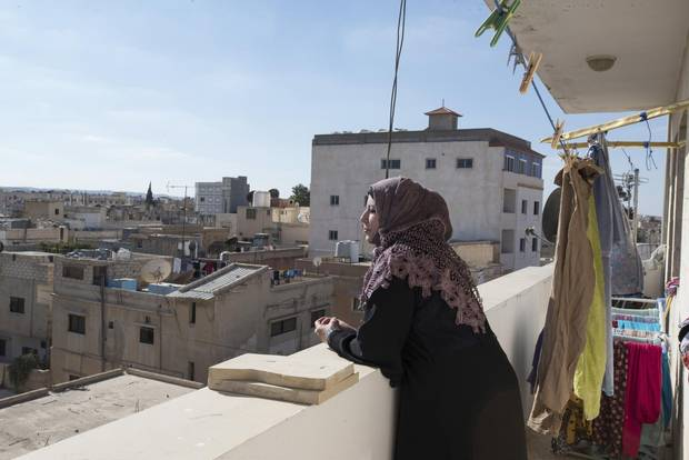 Maison looks out at the rooftops in Mafraq. She hopes to return to nursing in Syria once the conflict has ended.