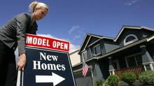 The 20-city S&P Case-Shiller home price index for July rose for a sixth straight month. (DON RYAN/AP)