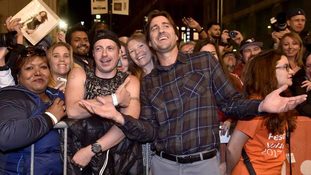 Luke Wilson hams it up for the camera with fans outside a showing of his film Brad's Status at the Toronto International Film Festival on Saturday, Sept. 9, 2017.