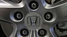 A logo of Honda Motor on a wheel is pictured at its showroom in Tokyo May 17, 2011. (YURIKO NAKAO/REUTERS)
