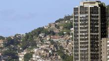 An apartment building in front of the Rocinha favela in Rio de Janeiro. (BRUNO DOMINGOS/REUTERS)