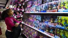 A girl looks up at a toy sales display in a JC Penney store in this Nov. 29, 2013 file photo. Figures released on Jan. 14, 2014, will reveal how U.S. retailers performed during the holiday season. (LUCAS JACKSON/REUTERS)