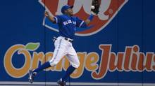 Toronto Blue Jays right fielder Rajai Davis misses a catch hit from Chicago White Sox DH Paul Konerko during fourth inning AL baseball action in Toronto on Wednesday, April 17, 2013. (Nathan Denette/THE CANADIAN PRESS)