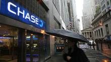 A woman passes a branch of Chase Bank in New York's financial district. (Mark Lennihan/AP)
